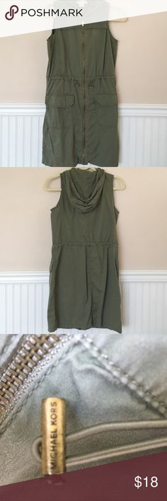 MICHAEL Michael Kors Coverup This sleeveless cover-up has a full zipper front, drawstring waist, and hood. Measures approximately 33 1/2 inches. Content: 100% cotton. MICHAEL Michael Kors Swim Coverups