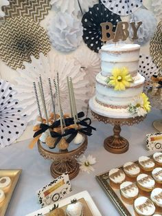 Amazing desserts at a white, black and gold baby shower party! See more party planning ideas at CatchMyParty.com!