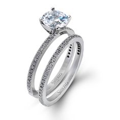 Simon G - Classy Collection - This gorgeous 18K white engagement ring and band is comprised of .30ctw round white Diamonds. - PR108