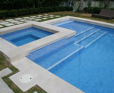 Glass Mosaic Pool Tiles Light Blue. Ref # 110 You can see we have a large selection of blue glass tile. Glass tiles at and above the pool waterline offer an opportunity for unique and colorful designs. Look at the some great glass tile pool pictures from projects completed by our clients.  Pool Builders in Miami, Mosaic glass tiles installed in a swimming pool are also growing in popularity due to their versatility and functional qualities.