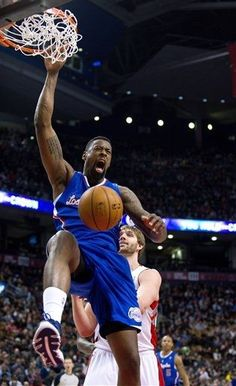 Los Angeles Clippers forward DeAndre Jordan dunks in front of Toronto Raptors forward Aaron Gray during the first half of an NBA basketball game in Toronto on Friday, Feb. 1, 2013. (AP Photo/The Canadian Press, Galit Rodan)