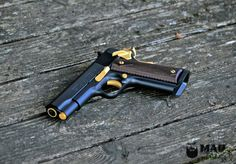 Here is a Colt Commander 199 done up killer in a Cerakote Graphite Black with Gold accents. Very nice gun! 1911 Grips, 1911 Pistol, Colt 1911, Heckler & Koch, Guns And Ammo, Shotgun, Custom Paint, Firearms, Hand Guns