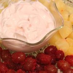This is a great, Super Easy Fruit Dip Allrecipes.com.  Do NOT use plain yogurt, but all others work great!  Healthier than the ones with Cream Cheese and fluff!