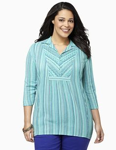 Vertical stripes offer a slimming effect on this twinkling, sequined tunic. The V-neckline is finished with a discrete, button-front design with looped closures that end at mid-chest. Sequin accents provide a lovely glow along at the center. Features three-quarter sleeves, with looped, button closures. Catherines tunics are designed for the plus size woman to guarantee a flattering fit. catherines.com
