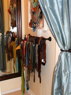 Towel bar to organize belts