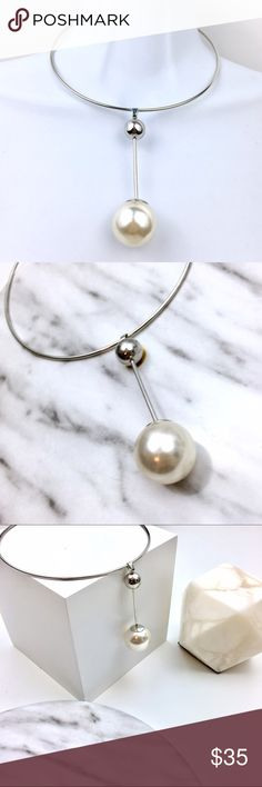 Minimalistic Pearl Drop Choker Necklace Ready to simplify your jewelry statement game? How about this choker with a drop pearl  hanging from another silver ball. This screams minimalist and refinement. Wear this with a super simple white tunic dress and some flats. Wear it on top of black turtle neck body suit. Just keep it simple. Is this a gift? Let me know to make you a . Boutique Jewelry Necklaces