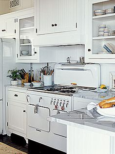 white kitchens are the best kitchens. love the vintage style oven and stove!