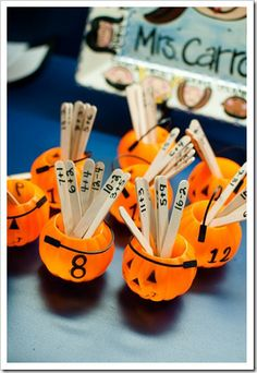 Jack O'Lantern Addition/Subtraction Sorting.  Write a different number on each jack o'lantern {6-18}.  Then take popsicle sticks and write a different math fact on each….about 6 facts for each number…4 addition problems and 2 subtraction problems. The kids sort the math facts into the corresponding jack o'lanterns and when they're finished, they can record their sorts onto a little pumpkin!