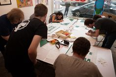 The gang hard at work designing and preparing stencils.