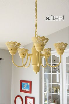 foil doilies painted (center cut out) and used to replace glass on this revamped chandelier turned upside down