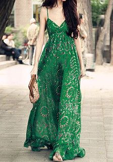 Full-length front view of model in green printed maxi dress