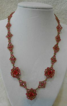 This is my 'take' on Sidonia's 'Sweet Romance' tutorial on YouTube. Linda featured the pattern and created bracelets using the smaller motif. I used Swarovski Indian Pink crystals throughout.