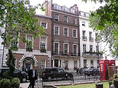 "Townhouses on Berkeley Square (pronounced ""Barkley"") in the tres tres fancy pants Mayfair neighborhood in London."