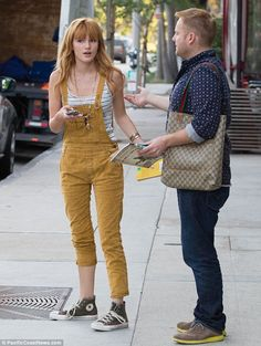 Comfy and cool: Bella added a pair of Converse to her outfit and a long pendant necklace