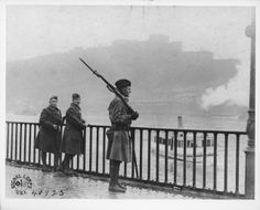 "Soldiers of the 1st Division keep ""Watch on the Rhine"" at Coblenz, Germany, 12 December 1918, during the initial phases of the Allied occupation of Germany following the armistice."