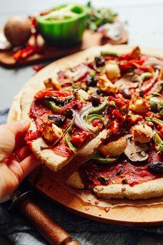 PERFECT Gluten-Free Pizza Crust! Fluffy, crispy, easy to make, 10 ingredients! #vegan #glutenfree #pizza #recipe #plantbased #minimalistbaker