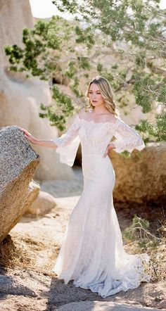 Allure Bridals wedding dress; Style: F100-Camellia Camellia features an off-shoulder neckline scalloped in eyelash lace, along with sheer, elbow length bell sleeves.