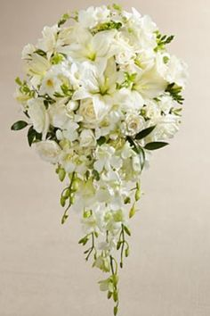 The FTD® White Wonders™ Bouquet is an exquisite display of wedding elegance. An incredible array of white blooms, including Dendrobium Orchids, roses, Asiatic Lilies, freesia, spray roses, and mini hy