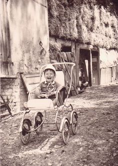 Happy toddler in a carriage