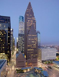 Bank of America Center   700 Louisiana Street   Houston, TX  This building was completed in 1983. It has 56 stories and is a 1.5 million-gross-square-foot office tower with an adjacent 12-story (125-foot-high) banking hall. The neo-Gothic building, designed by Philip Johnson and John Burgee, is made from Napoleon red granite and reflective glass.