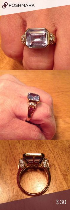 Pre-Loved Emerald Cut Bezzled 14K Clad Ring Emerald Cut Aquamarine colored Tourmaline ring flanked by 7 CZs on each side and a square-cut ruby red stone know each side. 14K Clad. Very good condition. Tova Jewelry Rings