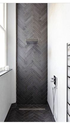 Love the herringbone tiles | moody grey tiles | minimalist shower | bathroom interior