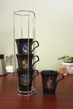 Harry Potter-Stackable House Crest Mugs -@- http://geekarmory.com/harry-potter-stackable-house-crest-mugs/
