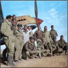 Pilots of No. 112 Squadron RAF grouped round the nose of one of their Curtiss Tomahawk IIBs at LG 122, Fort Meddelena, Egypt. November 30 1941.