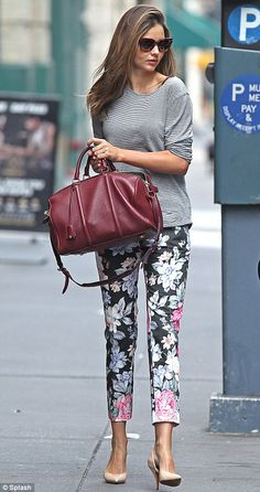 Leggy lady: Miranda Kerr headed to a photo shoot in downtown Manhattan on Sunday in floral print pants