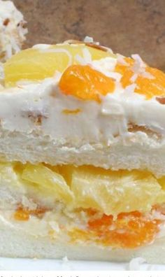 Ambrosia Cake - An angel food cake with lots of fresh flavor. The pineapple, mandarin oranges, and toasted coconut give this cake recipe a tropical flair.