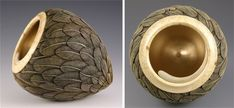 feathered pot sculpture flowing out from bottom swirling rim at top twists inward
