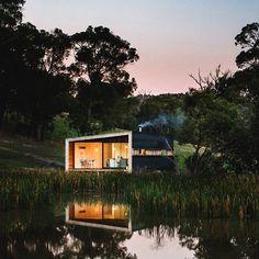 Quiet lakeside cabin built with minimalist design + rugged materials, via Dezeen