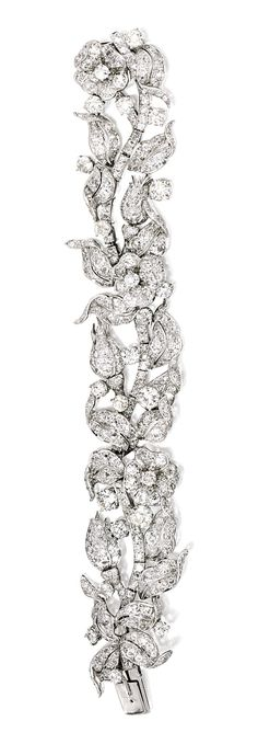 Verdura Platinum and Diamond 'Leaf and Flower' Bracelet. Designed as a meandering flowering vine, set with numerous old mine and old European-cut diamonds, approximately carats Diamond Bracelets, Diamond Jewelry, Bangle Bracelets, Bangles, Antique Jewelry, Vintage Jewelry, European Cut Diamonds, Flower Bracelet, Diamond Cuts