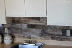 Remodelaholic | How To Install A Pallet Wood Back Splash inexpensive backsplash idea.