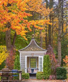 Fiery maples overhang the pool house, an ode to one of the garden pavilions at England's Hidcote Manor Garden. - Photo: Joseph Valentine