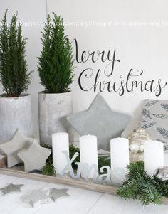 Adventskranz-Alternative: Weiße Kerzen mit Betonsternen
