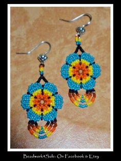 Huichol Chaquira Style Flower Earrings. $18.00, via Etsy.