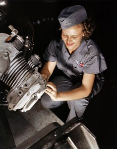 Mary Jo Farley (Tilton) working on an aircraft engine before becoming a Woman Airforce Service Pilot -- WASP WWII.