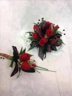 red roses with black accents create stunning corsage and boutonniere