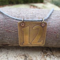Etched brass 12 necklace fan number 12 by WhyitsmeDesign