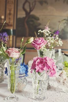 I like the way this looks with different kinds of crystal vases  crystal vase wedding flowers http://www.joannabrownphotography.com/