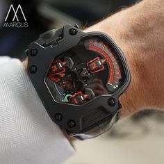 Urwerk UR-110 in black and red with titanium case and platinum bezel. Hammerhead on the wrist.