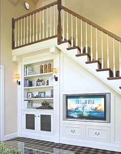 There are lots of methods to create under stair storage space. I really like the manner that this under stair storage space stipulates a desk area for those kids. Living Room Under Stairs, Space Under Stairs, Under Stairs Playhouse, Living Rooms, Staircase Storage, Staircase Design, Staircase Ideas, Stairs With Storage, Stair Design