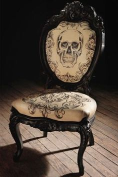 Awesome gothic skull chair, would make a great chair for my vanity