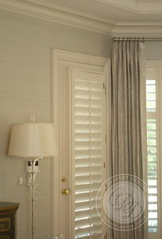 Plantation Shutters On A Front Door Exterior View
