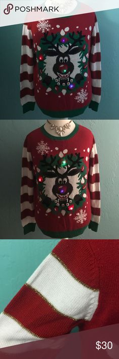 LIGHTUP Ugly Christmas Rudolph Reindeer Sweater The perfect Christmas/holiday sweater for parties and get togethers or just to get into the holiday spirit!! Super soft. All the lights work and switch colors automatically when you move. Sparkly thread in the stripes on sleeves too. Perfect condition! Size large. Reasonable offers always accepted.  Ugly Christmas Sweater Sweaters