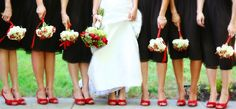 What a surprise!  I love the red shoes and the coordinating bridal bouquet of red roses!