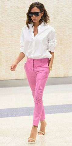 Victoria Beckham. Pink chinos and a classic white shirt.