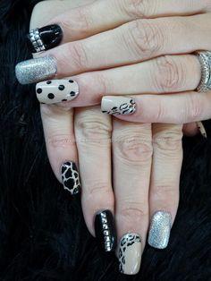 nude black and silver polish with studs, polka dots and animal print nail art