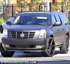 Beckham in his sexy matt black Cadillac Escalade. Just one of his 40 cars!